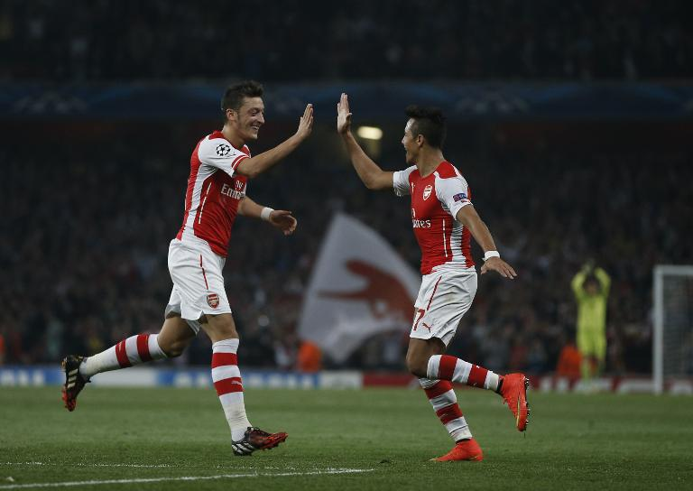 wpid-arsenals-alexis-sanchez-r-celebrates-scoring-his-goal-with-mesut-ozil-during-the-uefa-champions-league-football-match-between-arsenal-and-galatasaray-in-london-on-october-1-2014.jpg