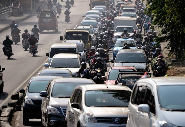 wpid-jakarta-is-infamous-for-monster-traffic-snarl-ups-rubbish-strewn-pot-holed-roads-heavy-pollution-and-flooding-that-engulfs-poor-slum-areas-every-year.jpg