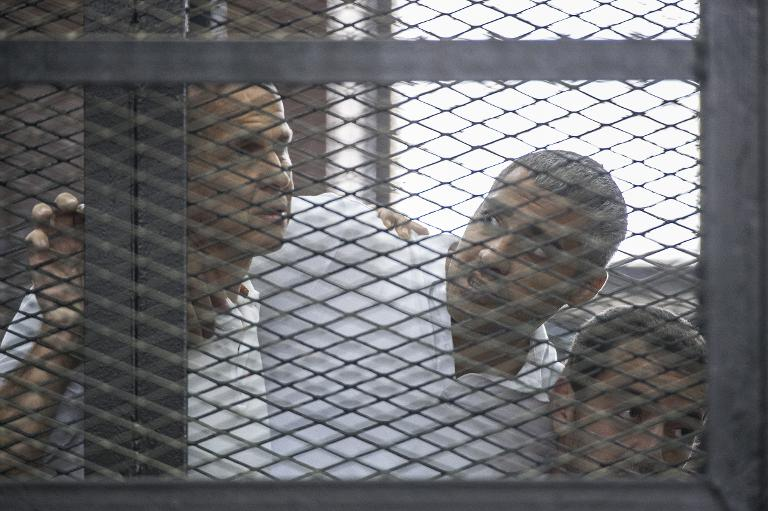 wpid-al-jazeera-journalists-peter-greste-left-mohamed-fadel-fahmy-centre-at-the-police-institute-near-cairos-tora-prison-on-june-23-2014.jpg
