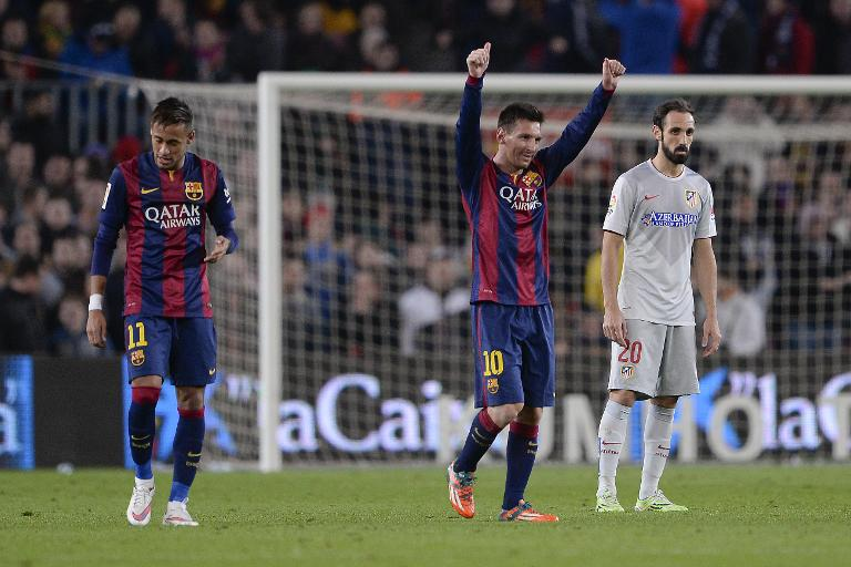 wpid-lionel-messi-centre-celebrates-a-goal-as-team-mate-neymar-and-atletico-madrid-defender-juanfran-watch-during-a-spanish-league-match-at-the-camp-nou-stadium-in-barcelona-on-january-11-2015.jpg