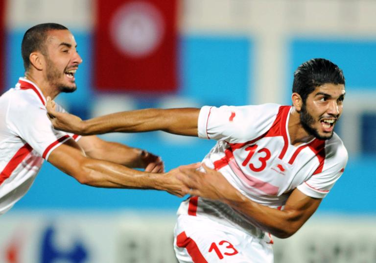 wpid-tunisias-ferjani-sassi-r-celebrates-with-teammate-stephane-houcine-nater-after-scoring-during-the-africa-cup-of-nations-qualifying-match-against-senegal-in-monastir-on-october-15-2014.jpg