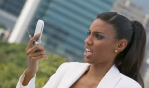 black-woman-looking-at-cell-phone-310x184