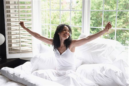 619-03660887 © Masterfile Royalty-Free Model Release: Yes Property Release: Yes Black woman waking up in bed