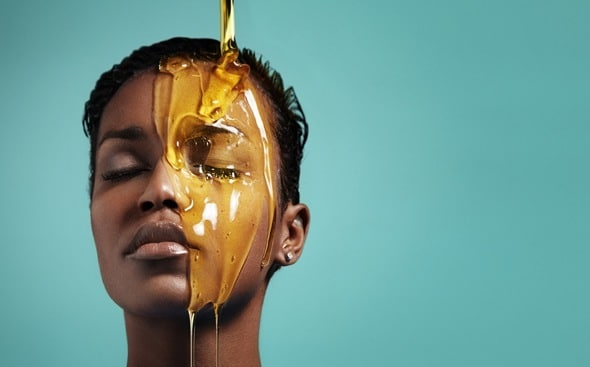 woman-with-honey-dripping-over-face