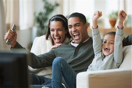 619-05514397 © Masterfile Royalty-Free Model Release: Yes Property Release: Yes Family watching television together