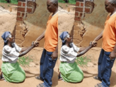 A Ugandan woman kneeling before her man