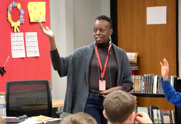 Njeri Wangari, a poet from Nairobi, Kenya, works with students at Stillwater Middle School on Tuesday, May 7, 2019. Wangari came to Stillwater to teach a two-week session on poetry, at Oak-Land and Stillwater Middle schools. (Courtesy of  Chris Freichels)