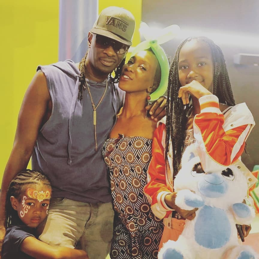 Nameless, his wife Wahu and kids in a loving embrace