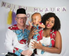 Isaac Mwaura with his wife and son