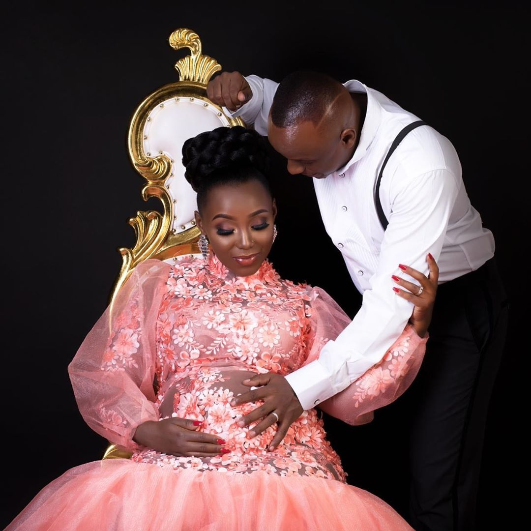 Phil Karanja holding his wife's stomach