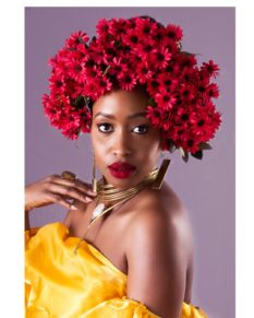 Janet Mbugua with roses on her head