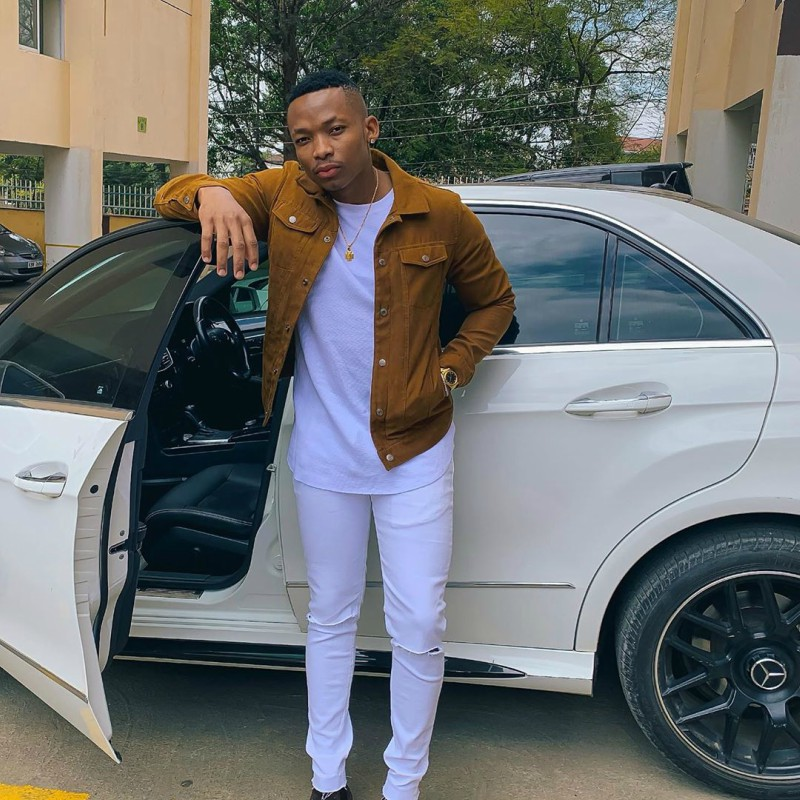 Otile Brown with seating on his white Mercedes Benz