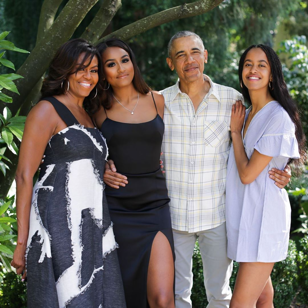 Barack Obama with Michelle and their daughters