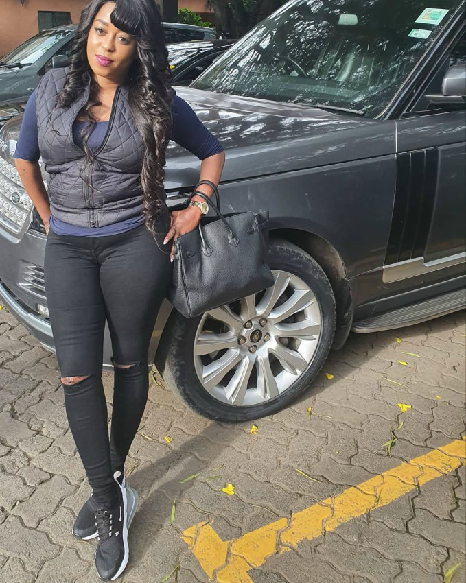 Lillian Muli leaning on her Range Rover