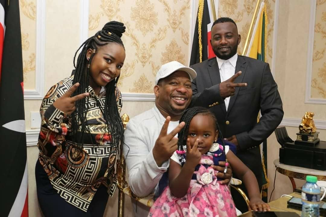 Sonko with his daughter Saumu and Anwar in the past