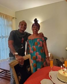 Prezzo with his mother