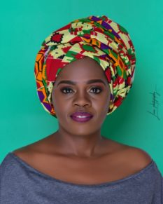 Betty Bayo wearing headwrap