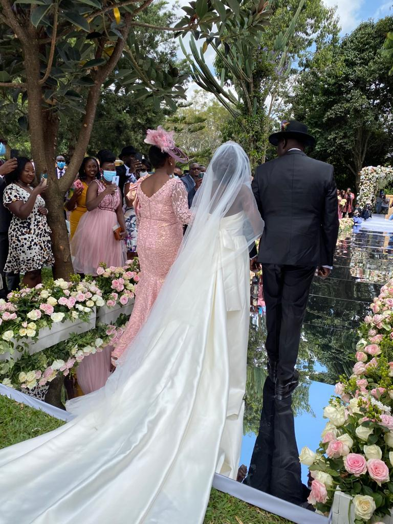William Ruto with his daughter June at her wedding